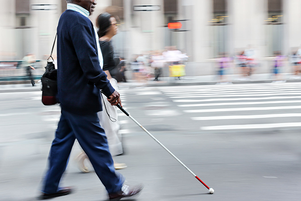 Blind person walking